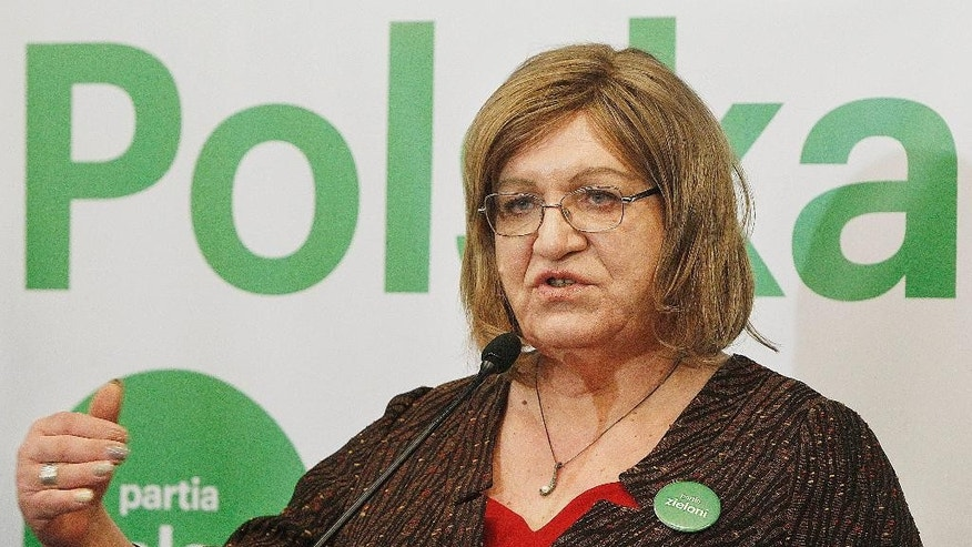 "FILE - In this file photo from Feb. 13, 2015, Anna Grodzka, Poland's only transsexual lawmaker, launches a campaign to run for president as the candidate for the Green party.  Slogan in back reads ""Polska Fair,"" or ""A Fair Poland."" Grodzka was elected to the parliament in 2011 as part of a left-wing party, in what seemed to be a symbol a Poland growing more open and tolerant to LGBT rights. But a recent election brought victory to a right-wing party and will create parliament with no left-wing at all.  (AP Photo/Czarek Sokolowski,file)"