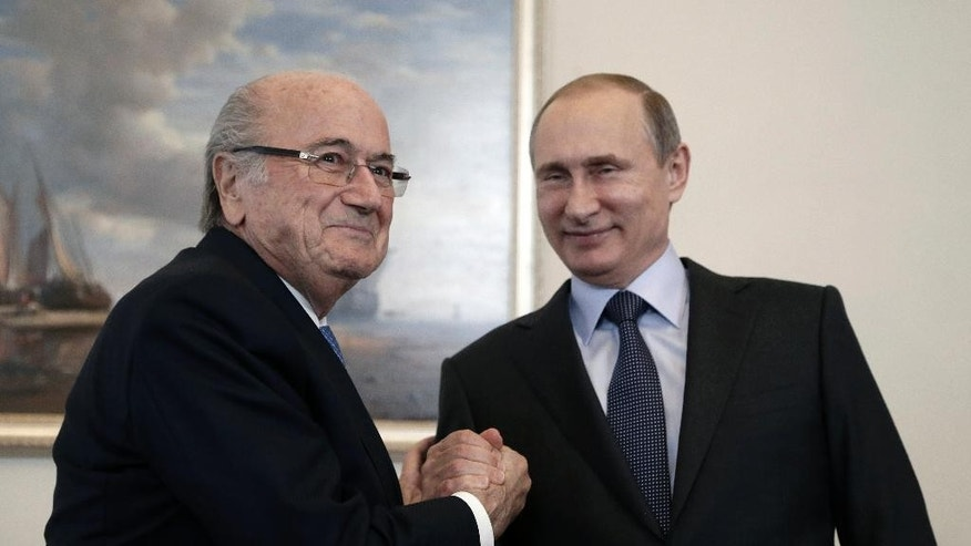"FILE - This is a  Saturday, July 25, 2015  file photo of Russian President Vladimir Putin, right, and FIFA President Sepp Blatter as they meet before the 2018 World Cup preliminary draw in the Konstantin palace in St. Petersburg, Russia. Taking a dictatorial approach to his role as FIFA president, Sepp Blatter lashed out at the ethics committee for being ""against me"" and criticized his 90-day ban as being ""total nonsense.""  Blatter, who was suspended along with Michel Platini, made the comments during a wide-ranging and stinging interview published Wednesday Oct. 28, 2015 by Russian state news agency Tass.   (Maxim Shipenkov/Pool Photo via AP, File)"