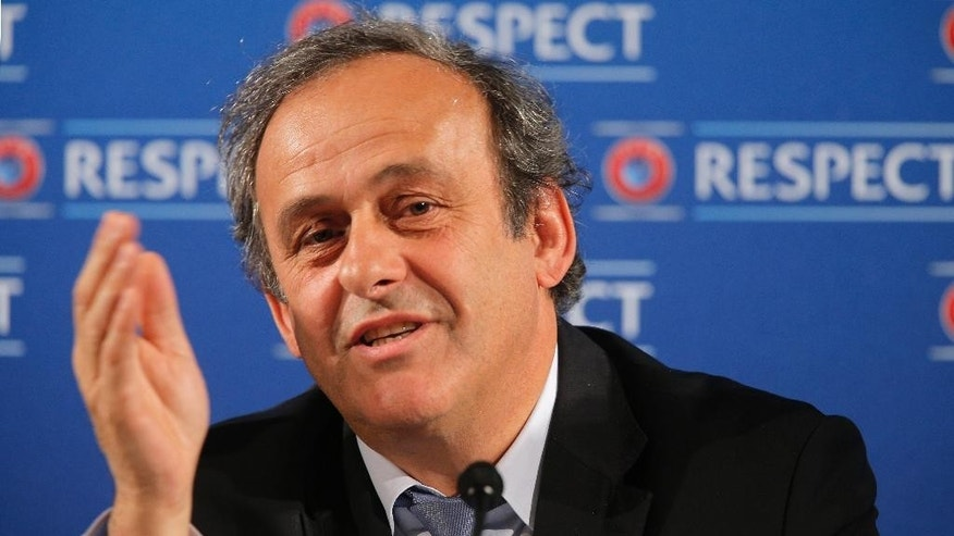 FILE - In this file photo dated Saturday, Feb 22, 2014, UEFA President Michel Platini gestures during a press conference, one day prior to the UEFA EURO 2016 qualifying draw at the Acropolis Convention Centre in Nice, southeastern France. Seven men are in the running to replace Sepp Blatter as FIFA president, with Michel Platini's candidature pending because of his suspension from soccer.   (AP Photo/Lionel Cironneau, FILE)
