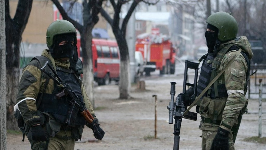 FOR STORY RUSSIA ISLAMIC STATE THREAT Wednesday Oct.28, 2015 - FILE - In this Monday, Jan. 20, 2014 file photo, Russian special force soldiers wear masks during an anti-terrorist operation in Makhachkala, regional capital of Dagestan, Russia. The Russian province of Dagestan, a flashpoint for Islamic violence in the North Caucasus, is feeding hundreds of fighters to the Islamic State in Syria, officials say, and now some are coming back home with experience gained from the battlefield. (Abdula Magomedov/NewsTeam via AP,  File)
