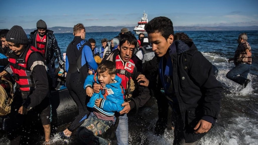 Afghan migrants arrive on the shores of the  Greek island of Lesbos after crossing the Aegean sea from Turkey on an overcrowded dinghy , Tuesday, Oct. 27, 2015. Greece's government says it is preparing a rent-assistance program to cope with a growing number of refugees, who face the oncoming winter and mounting resistance in Europe. (AP Photo/Santi Palacios)