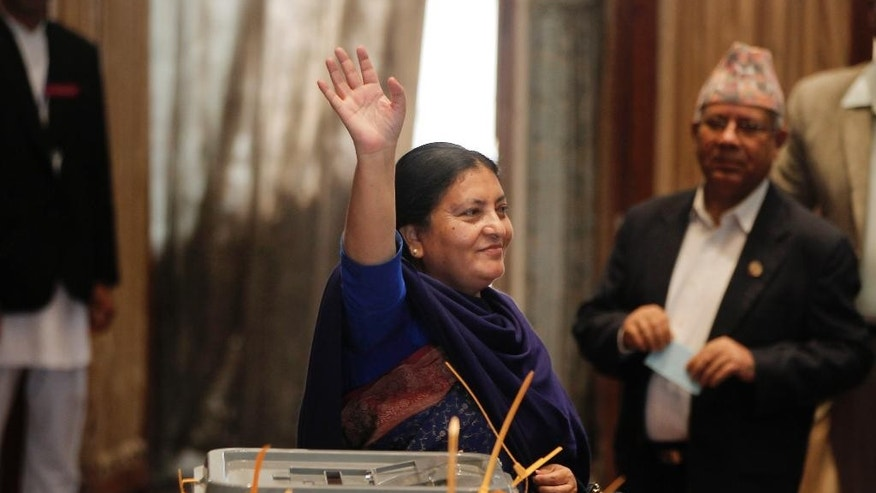 Presidential candidate and vice-chairperson of the Communist Party of Nepal (Unified Marxist-Leninist) Bidhya Bhandari waves her hand after casting vote as lawmakers vote for a new president in Kathmandu, Nepal, Wednesday, Oct. 28, 2015. The prime minister is Nepal's leader, while the president is the ceremonial head.The new constitution adopted last month requires Nepal to name a new president.(AP Photo/Niranjan Shrestha)