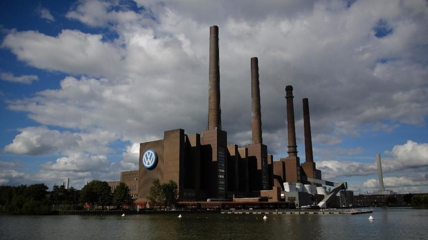 FILE - This Sept. 29, 2015 file photo shows the power plant of the Volkswagen factory in the city of Wolfsburg, Germany. Volkswagen is reporting a loss of 1.67 billion euros (US dollar 1.83 billion) in the third quarter, Wednesday, Oct. 28, 2015, as earnings took a hit from 6.7 billion euros in set-asides for recalls and fines connected to cars rigged to evade U.S. diesel emissions testing. (AP Photo/Markus Schreiber)