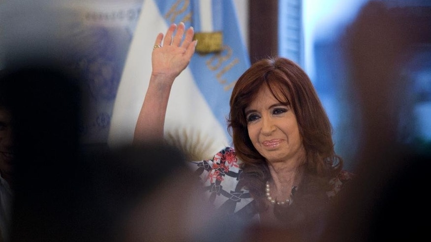 Argentina's President Cristina Fernandez waves to supporters at the government house in Buenos Aires, Argentina, Thursday, Oct. 29, 2015. Fernandez's chosen successor presidential candidate Daniel Scioli will face opposition candidate Mauricio Macri in a presidential runoff election on Nov. 22.  (AP Photo/Natacha Pisarenko)