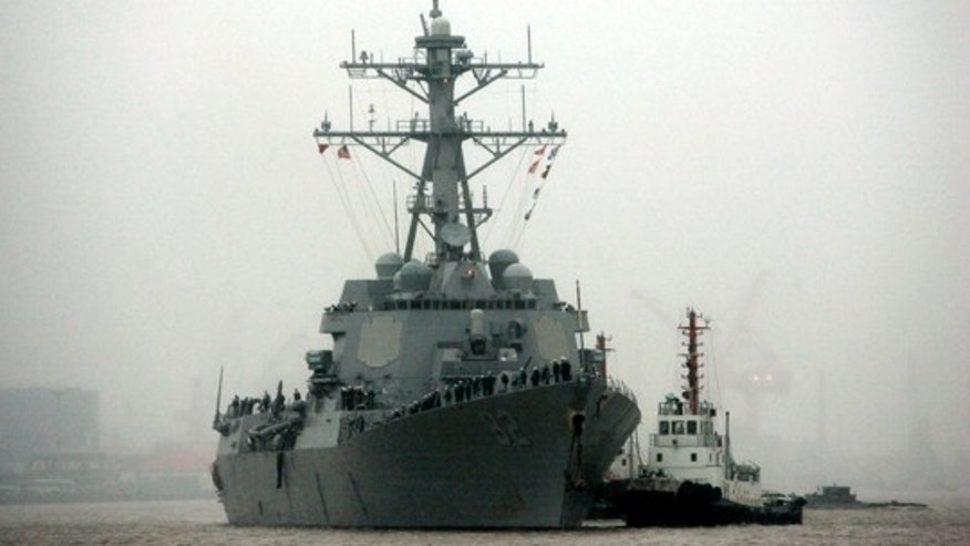 In this April 8, 2008, file photo, guided missile destroyer USS Lassen arrives at the Shanghai International Passenger Quay in Shanghai, China, for a scheduled port visit. (AP Photo/Eugene Hoshiko, File)