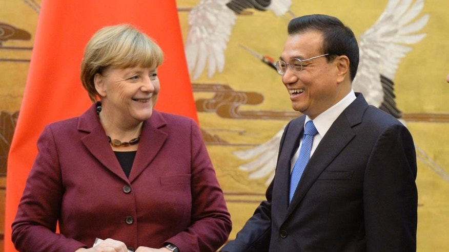 German Chancellor Angela Merkel, left, and Chinese Premier Li Keqiang smile after a signing ceremony at the Great Hall of the People in Beijing Thursday, Oct. 29, 2015. (Muneyoshi Someya/Pool Photo via AP)
