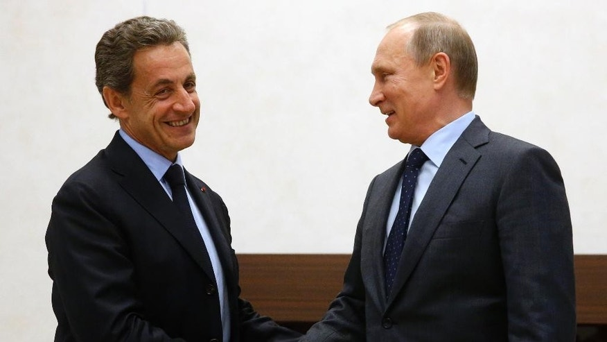 Russian President Vladimir Putin, right, and former French President Nicolas Sarkozy shake hands during their meeting in the Novo-Ogaryovo residence outside Moscow, Russia, Thursday, Oct. 29, 2015. (Sergei Chirikov/Pool Photo via AP)