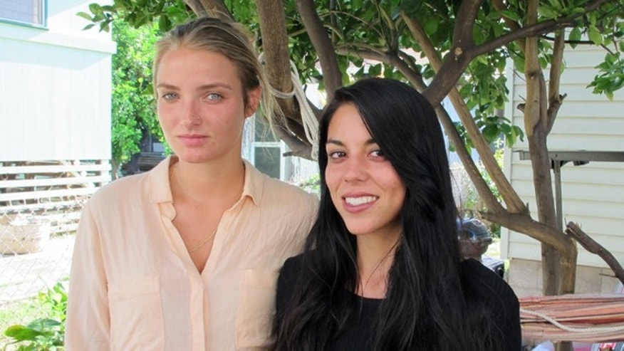 Courtney Wilson, left, and Taylor Guerrero pose for a photo in Honolulu on Wednesday, Oct. 28, 2015.