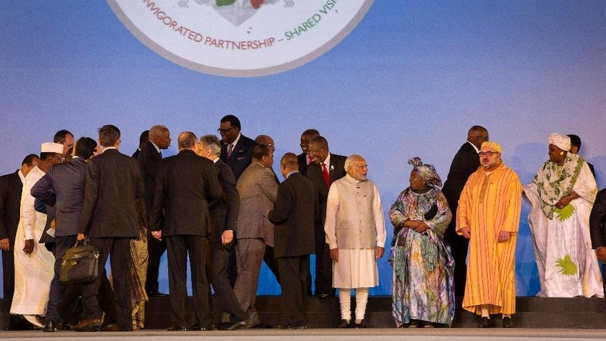 Indian Prime Minister Narendra Modi, third right, talks to African Union Commission chairperson Nkosazana Dlamini-Zuma, as other African leaders interact after a group photograph at the India Africa Forum Summit in New Delhi, India, Thursday, Oct. 29, 2015. More than 40 African leaders are in New Delhi to attend the IAFS 2015, preceded by meetings of trade and foreign ministers from nearly all 54 African nations, to explore how Indian investment and technology can help a resurgent Africa face its development challenges. (AP Photo/Manish Swarup)