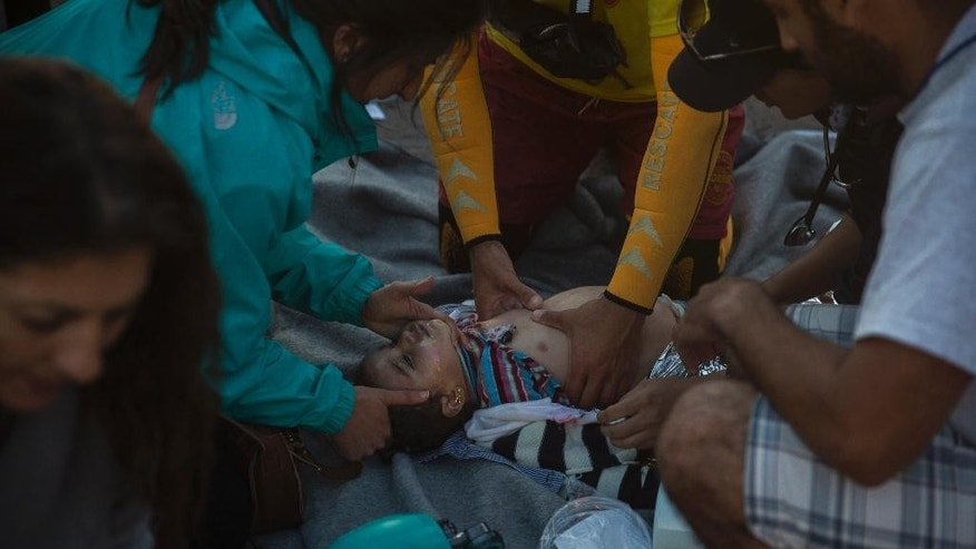 Oct. 28, 2015: Paramedics try to revive a baby after a boat with refugees and migrants sunk while was crossing the Aegean sea from Turkey.