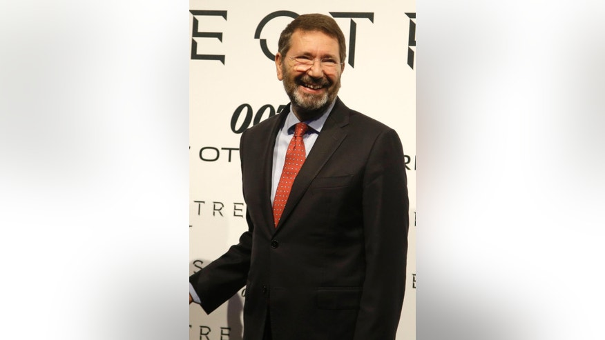 In this photo taken on Tuesday, Oct. 27, 2015, Rome Mayor Ignazio Marino smiles during the red carpet for the latest James Bond film 'Spectre' in Rome. Rome is the Eternal City, but its mayor's decision to quit the helm of corruption-plague Italian capital, didn't last very long. Mayor Ignazio Marino announced on Thursday, Oct. 29, 2015 he withdrew his resignation of two weeks ago. (AP Photo/Gregorio Borgia)