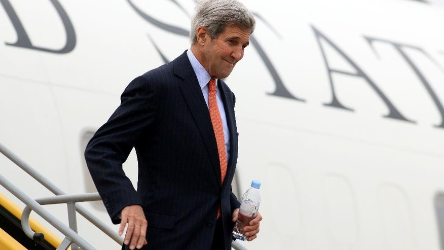 U.S. Secretary of State John Kerry arrives at Vienna's Schwechat airport, Austria, Thursday, Oct. 29, 2015. Kerry has arrived for talks on ending the Syrian war with other key nations, including bitter regional rivals Iran and Saudi Arabia. (AP Photo/Ronald Zak)