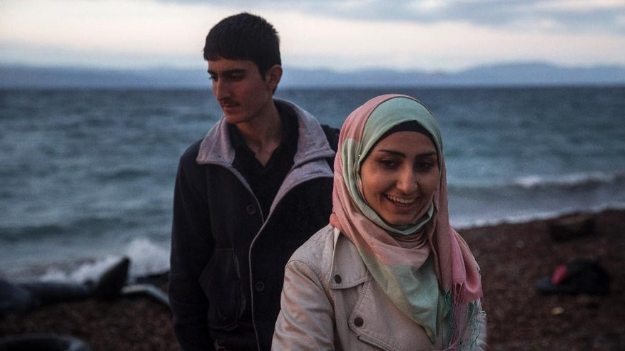 A girl and a boy react after arriving from the Turkish coast to the northeastern Greek island of Lesbos, Thursday, Oct. 29, 2015. Europe's largest refugee crisis since World War II is entering a perilous and uncharted phase, as the usual pattern of migrant season ending by autumn is overturned by intensifying fighting in Syria and overcrowding in refugee centers in Turkey and Lebanon.  (AP Photo/Santi Palacios)