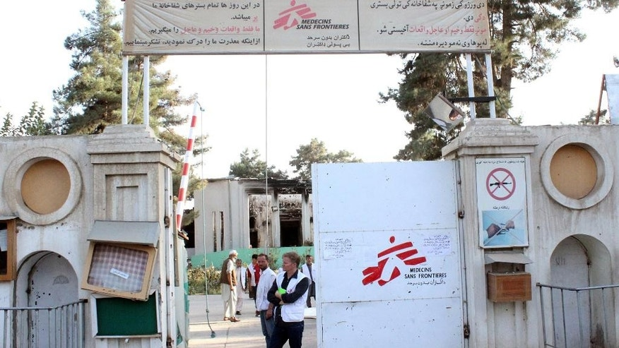 FILE -- In this Oct. 15, 2015 file photo, Christopher Stokes, the general director of medical charity Doctors Without Borders, which is also known by its French abbreviation MSF, stands at the gate of the organization's hospital, after it was hit by a U.S. airstrike in Kunduz, Afghanistan. Russian airstrikes have reportedly hit at least a half dozen medical facilities in Syria, according to activists. In Yemen, an airstrike by the Saudi-led coalition hit a hospital run by Doctors Without Borders. Still, apart from rights groups' condemnations, there's been little international outcry, in contrast to a U.S. strike on a hospital in Afghanistan that killed 30 people. (Najim Rahim via AP, File)