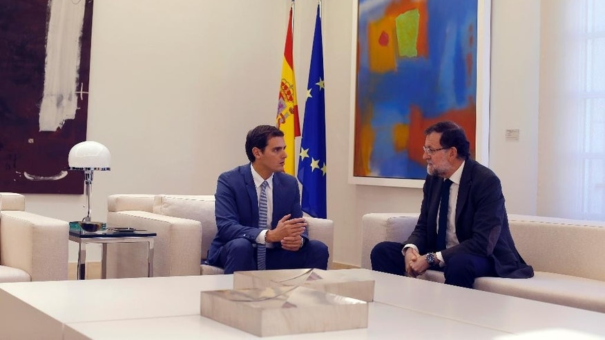 Spain's Prime Minister Mariano Rajoy, right, talks to Ciutadans ('Citizens') party leader Albert Rivera during their meeting at the Moncloa palace, Spanish premier's official resident, in Madrid, Friday, Oct. 30, 2015. Rajoy meets on Friday with the leaders of two new upstart political parties to discuss ways to halt attempts by secessionists in Catalonia to set the region on a path toward independence. (AP Photo/Francisco Seco)