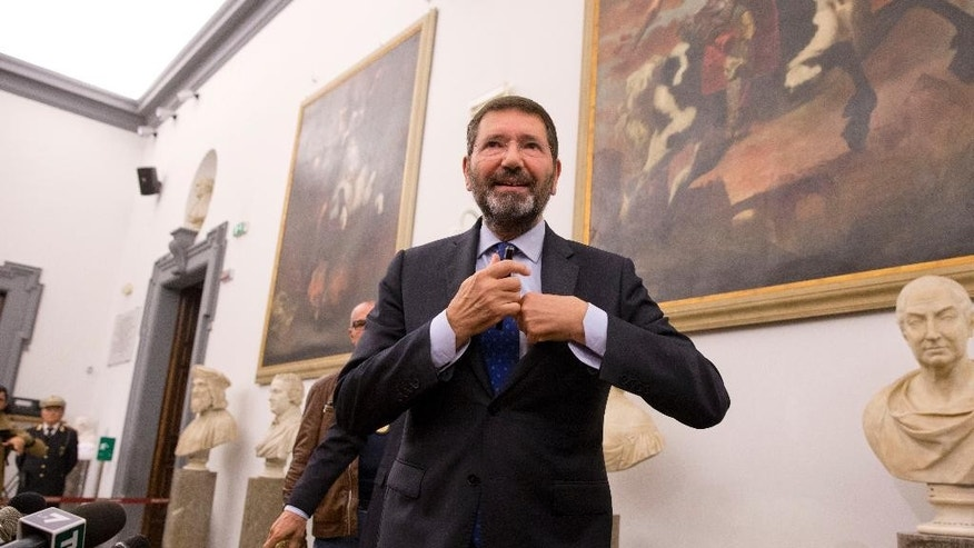 Ignazio Marino meets the media at Rome's Campidoglio Capitol Hill, Friday, Oct. 30, 2015. Just a day after rescinding his resignation, Rome's embattled mayor has acknowledged the end of his administration after the city council yanked its support. (AP Photo/Andrew Medichini)