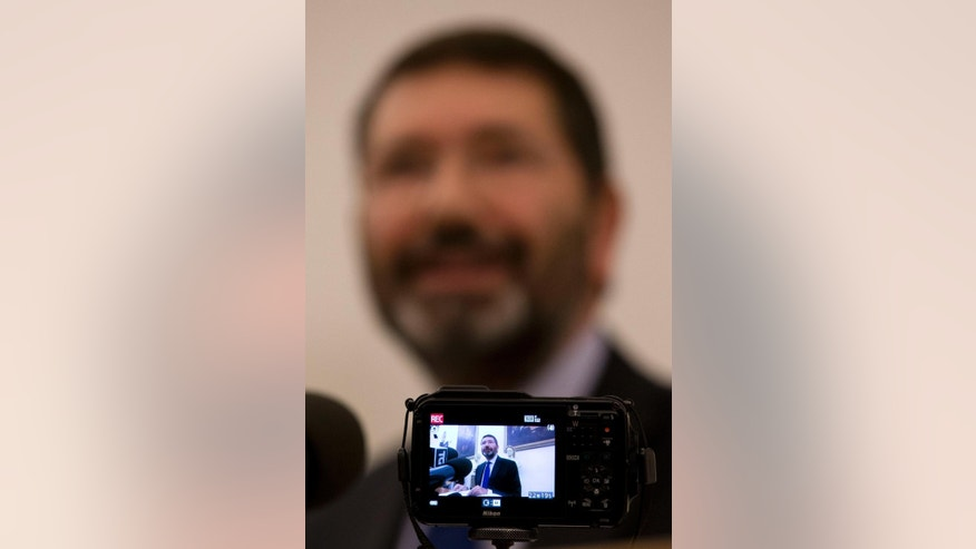A camera monitor frames Ignazio Marino as he meets the media at Rome's Campidoglio Capitol Hill, Friday, Oct. 30, 2015. Just a day after rescinding his resignation, Rome's embattled mayor has acknowledged the end of his administration after the city council yanked its support. (AP Photo/Andrew Medichini)