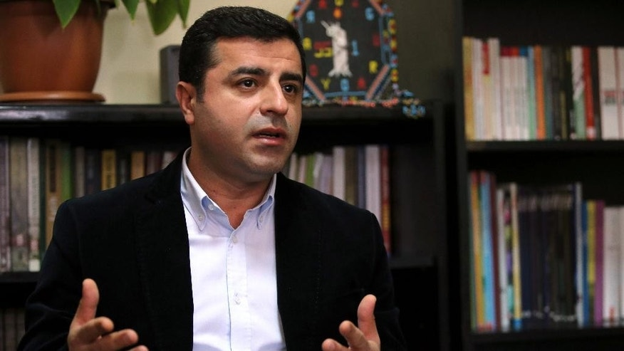 Selahattin Demirtas, co-chair of the pro-Kurdish Peoples' Democratic Party, (HDP), speaks during a press conference ahead of the Nov. 1 general elections, at Ozgur radio station in Istanbul, Turkey, Friday, Oct. 30, 2015. The election is a redo of June elections in which the ruling Justice and Development Party, or AKP, stunningly lost its majority. The ballot comes at a sensitive time for Turkey, a key Western ally that has major issues to navigate. (AP Photo/Hussein Malla)