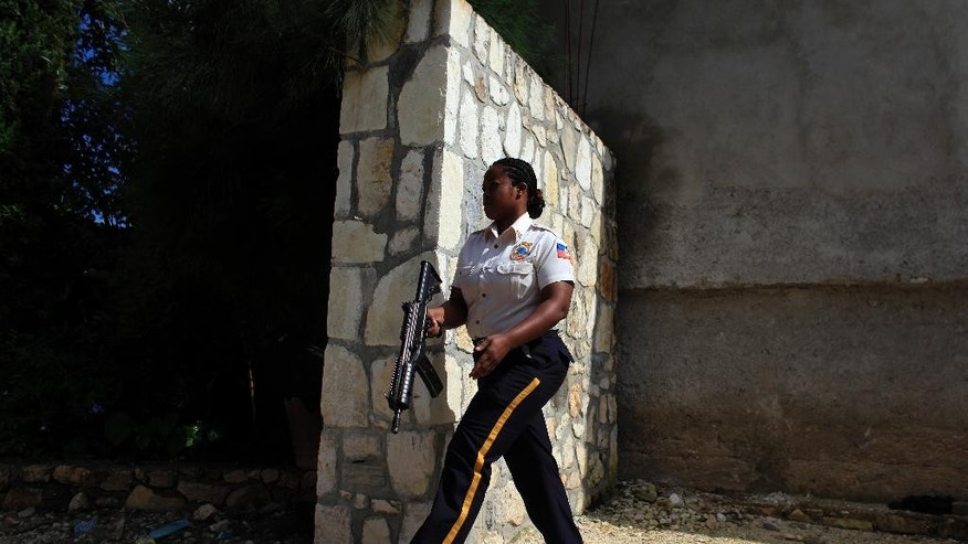 Police with an arrest warrant search unsuccessfully for Michael Geilenfeld at a private residence in the mountainside town of Kenscoff, on the outskirts of Port-au-Prince, Haiti, Friday, Oct. 30, 2015. Haitian investigators are looking into new allegations of child sex abuse against the U.S. man who founded an orphanage for boys in Haiti's capital decades ago and was already the subject of an earlier criminal case recently sent to an appeals court in the Caribbean country. (AP Photo/Ricardo Arduengo)