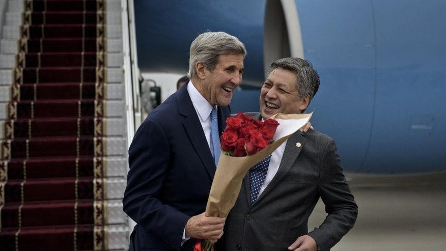 US Secretary of State John Kerry laughs with Kyrgyz Foreign Minister Erlan Abdyldaev upon his arrival at Manas International Airport in Bishkek. Kyrgyzstan on Saturday, Oct. 31, 2015. Kerry is on an official visit to the central Asian nations. (Brendan Smialowski/Pool Photo via AP)