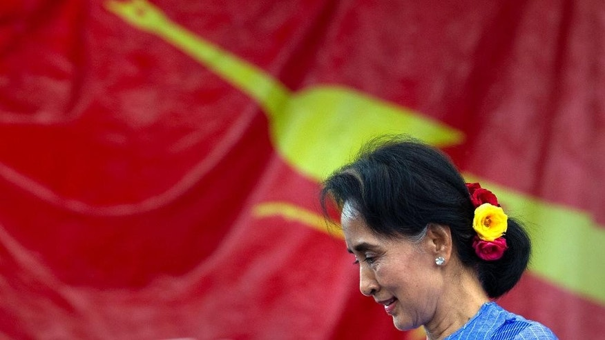 In this Sept. 11, 2015 photo, Myanmar's opposition leader Aung San Suu Kyi walks after delivering a speech during a campaign rally of her National League for Democracy party in Loikaw, Eastern Kayah State. Suu Kyi, whom the junta kept under house arrest for years, now tours the country stumping for votes. But even if her National League for Democracy wins the Nov. 8 election in a landslide, the odds are that the generals and their cronies will continue to dominate both politics and the economy. (AP Photo/Gemunu Amarasinghe)