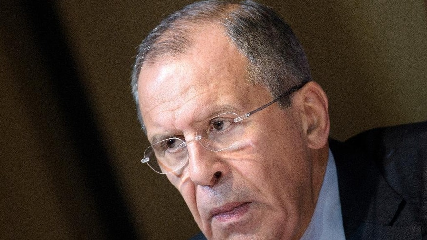 Russian Foreign Minister Sergei Lavrov listens during a news conference in Vienna, Austria, Friday, Oct. 30, 2015. The U.S., Russia and more than a dozen other nations have directed the U.N. to begin a new diplomatic process with Syria's government and opposition with the goal of reaching a nationwide cease-fire and political transition. (Brendan Smialowski/Pool via AP)