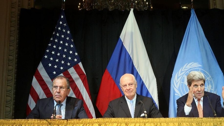 Russian Foreign Minister Sergey Lavrov, left, UN Special Envoy for Syria Staffan de Mistura and U.S. Secretary of State John Kerry, right, speake during a press conference after a meeting in Vienna, Austria, Friday, Oct 30, 2015. The United States, Russia, Iran and more than a dozen other nations agreed Friday to launch a new peace effort involving Syria's government and opposition groups, but carefully avoided any determination on when President Bashar Assad might leave power — perhaps the most intractable dispute of the conflict. (AP Photo/Ronald Zak)