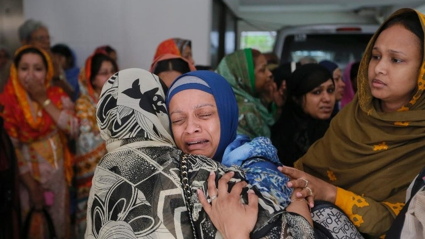 Relatives cry after seeing the body of  Faisal Arefin Deepan, a publisher of secular books, in Dhaka, Bangladesh, Sunday, Nov. 1, 2015. Deepan was hacked to death and three other people wounded in fresh attacks in Bangladesh's capital that were claimed by Muslim radicals, and a human rights group called on the government to urgently protect freedom of expression. (AP Photo/ A.M. Ahad)