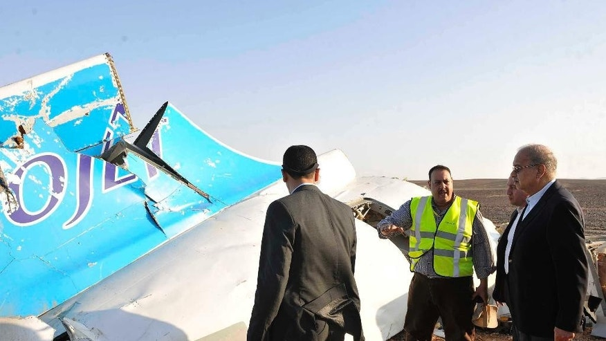 CORRECTS DAY OF WEEK TO SATURDAY, NOT FRIDAY - Egyptian Prime Minister Sherif Ismail, center, leaves the Zeinhom morgue after the arrival of bodies of Russian plane crash victims, Saturday, Oct. 31, 2015. A Russian aircraft carrying 224 people crashed Saturday in a remote mountainous region in the Sinai Peninsula about 20 minutes after taking off from a Red Sea resort popular with Russian tourists, the Egyptian government said. There were no survivors. (AP Photo/Mohammed El Raai)