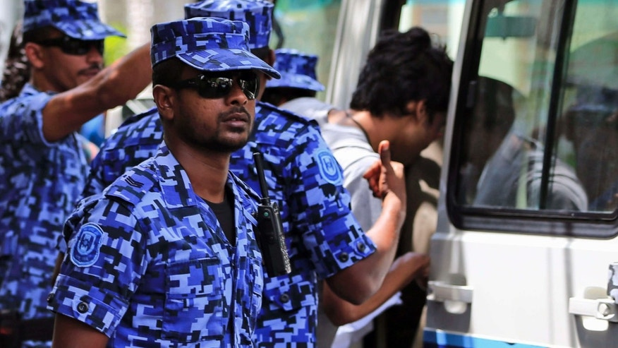 Oct. 24, 2015: Maldivian police force guard after the arrest of Vice President Ahmed Adeeb in Male, Maldives.