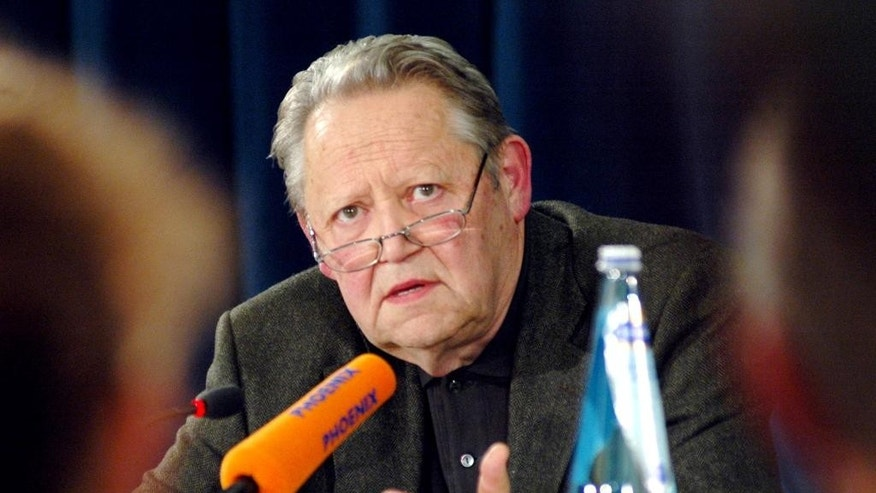 FILE - In this Aug. 31, 2004 file photo former member of the East German Politburo Guenter Schabowski talks to media in Bernau, near Berlin, Germany. Schabowski, whose cryptic announcement that the communist country was opening its fortified border precipitated the fall of the Berlin Wall in 1989, has died, his widow Irina Schabowski tells the German news agency dpa. He was 86 and died in a Berlin nursing home on Sunday, Nov. 1, 2015. (AP Photo/Sven Kaestner, file)