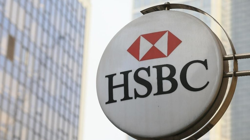 The sign for a branch of HSBC  near Liverpool Street Station in London, Monday Nov. 2, 2015 as the bank on Monday announced that their pre-tax profit has jumped by a third in the latest quarter. The bank, Europe's largest by market value, posted $6.1 billion in profit for the July-September period, up 32 percent from a year earlier, as it paid out less in fines, settlements and British customer compensation ordered by regulators. (AP Photo/Tim Ireland)