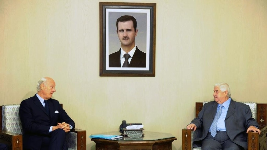 "In this photo released by the Syrian official news agency SANA, Syria's Foreign Minister Walid al-Moallem, right, meets with U.N. Special Envoy for Syria Staffan de Mistura in Damascus, Syria, Sunday, Nov. 1, 2015. Al-Moallem said ""important"" points were made during international talks aimed at reviving the peace process but that negotiators failed to convince his government's foes to curb their support for ""terrorism."" (SANA via AP)"