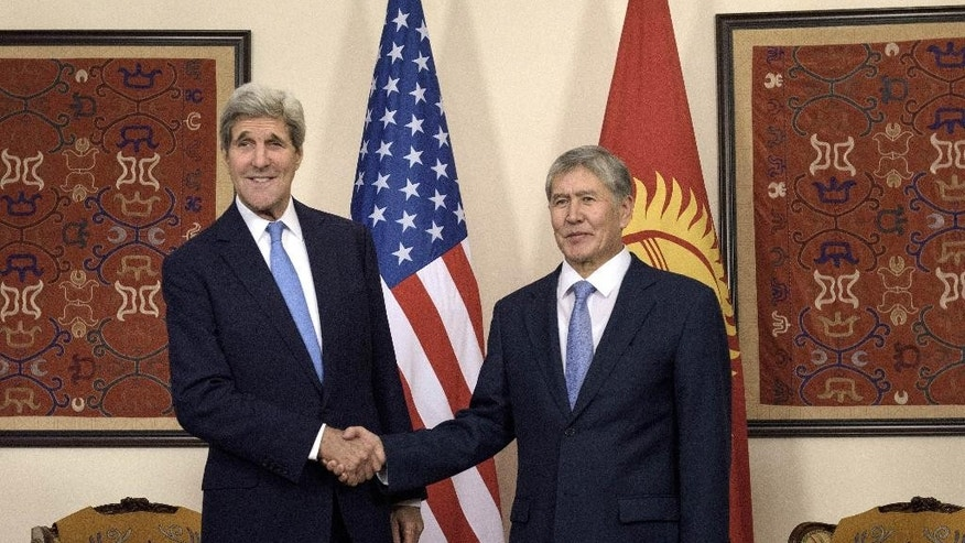"US Secretary of State John Kerry, left, and Kyrgyz President Almazbek Atambayev shake hands before a meeting on Saturday Oct. 31, 2015, in Bishkek. Kerry arrived in Central Asia for a five-day, five-nation tour of the ""Stans"", Kyrgyzstan, Uzbekistan, Kazakhstan, Tajikistan and Turkmenistan, to reassure them they will not be forgotten. (Brendan Smialowski / Pool via AP)"