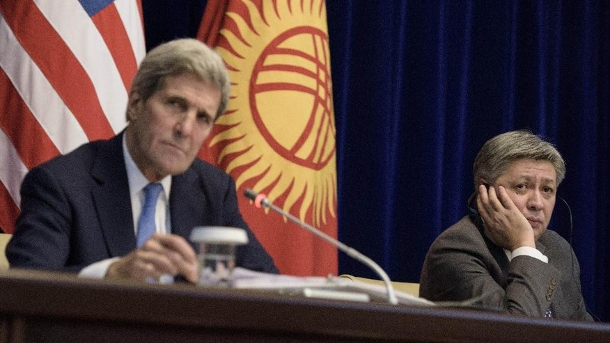 "US Secretary of State John Kerry, left, and Kyrgyz Foreign Minister Erlan Abdyldaev attend a press conference at the Ala Archa compound on Saturday Oct. 31, 2015, in Bishkek. Kerry arrived in Central Asia for a five-day, five-nation tour of the ""Stans"", Kyrgyzstan, Uzbekistan, Kazakhstan, Tajikistan and Turkmenistan, to reassure them, that they will not be forgotten. (Brendan Smialowski / Pool via AP)"
