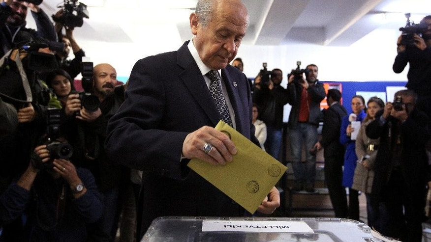 Turkey's opposition Nationalist Action Party leader Devlet Bahceli casts his vote at a polling station at a primary school in Ankara, Turkey, Sunday, Nov. 1, 2015. Turks headed to the polls Sunday for the second time in five months in what is being seen as a crucial general election that will determine whether the ruling party can restore the parliamentary majority it enjoyed for the past 13-years. (AP Photo)
