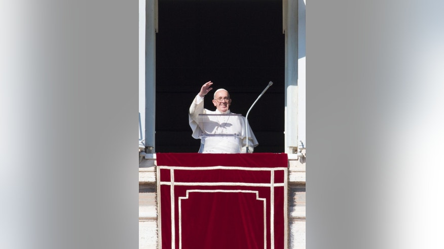 Pope Francis delivers his blessing during the Angelus noon prayer he celebrated from the window of his studio overlooking St. Peter's Square, at the Vatican,  Sunday, Nov. 1, 2015. (AP Photo/Andrew Medichini)
