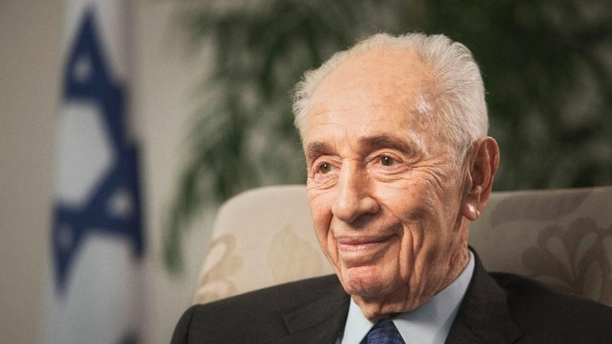 Former Israeli President Shimon Peres speaks during an interview with The Associated Press in Jerusalem, Monday, Nov. 2,  2015. In an unprecedented seven-decade political career, Shimon Peres has been there for all the highs and lows of Israel's tumultuous history. Now, amid another wave of violence, the indomitable 92-year-old elder statesman of Israeli politics worries that if the government doesn't change its ways Israel could be mired in an eternal state of conflict with the Palestinians that endangers its Jewish-majority status. (AP Photo/Dan Balilty)