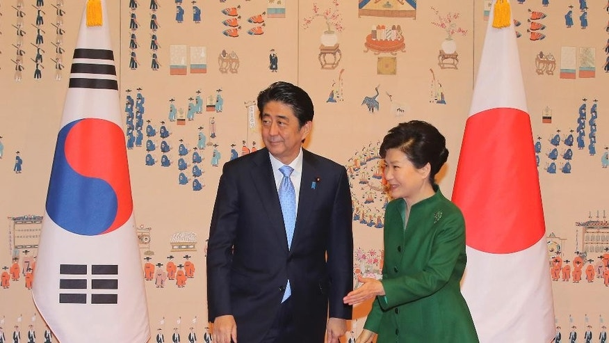 South Korean President Park Geun-hye, right, escorts Japanese Prime Minister Shinzo Abe before their meeting at the presidential Blue House in Seoul, South Korea, Monday, Nov. 2, 2015. (Lee Jung-hun/Yonhap via AP) KOREA OUT