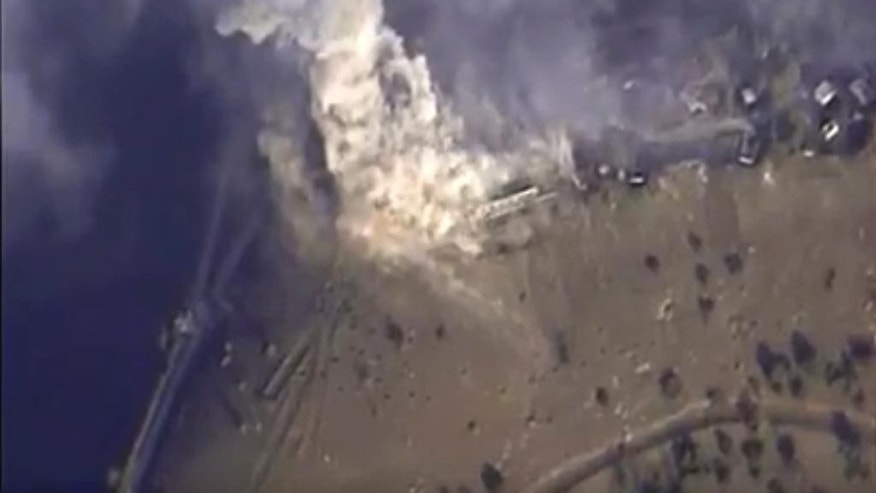 This photo made from the footage taken from Russian Defense Ministry official web site on Monday, Nov. 2, 2015 shows a target hit during s Russian air raid in Syria. Russian Defense Ministry said the strike was performed by an Su-34M bomber in Aleppo province. (AP Photo/ Russian Defense Ministry Press Service)