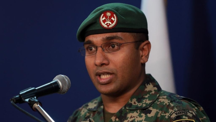 In this late Monday, Nov. 2, 2015 photo, Captain Ali Ihusaan, spokesperson of the Maldives National Defence Force, speaks to the media in Male, Maldives. The military on Monday found and deactivated an explosive device near the president's official residence, a top Maldives official said. The discovery came a month after an explosion occurred on President Yameen Abdul Gayoom's boat, injuring his wife, an aide and a bodyguard.  (AP Photo/Mohamed Sharuhaan)