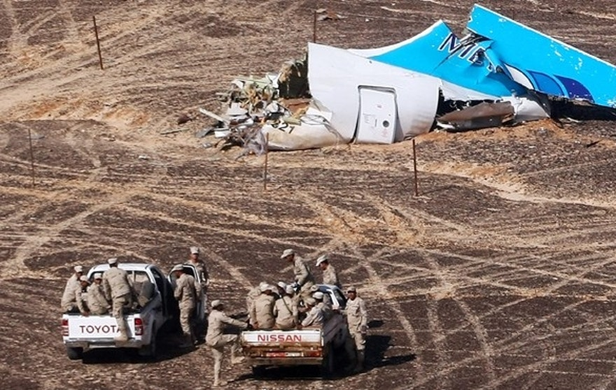 Nov. 2, 2015: Egyptian Military on cars approach a plane's tail at the wreckage of a passenger jet bound for St. Petersburg in Russia that crashed in Hassana, Egypt.