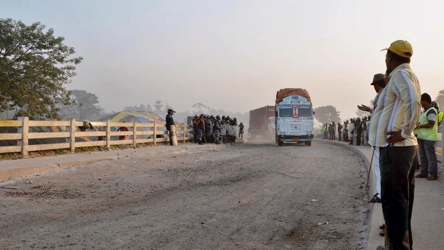 Trucks return to India from Birgunj, a town on the border with India, Nepal, Monday, Nov. 2, 2015. Nepalese police removed protesters from a key border point Monday to allow more than 200 vehicles stranded for the past 40 days to cross into India, officials said. (AP Photo/Ram Sarraf)