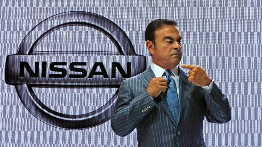 In this Oct. 28, 2015 photo, Nissan Chief Executive Carlos Ghosn gestures during the Japanese automaker's presentation at the Tokyo Motor Show in Tokyo.  Nissan's profit for the July-September quarter zoomed 38 percent higher on healthy sales in China, the U.S. and Europe, prompting the automaker to raise its full-year projections. Yokohama, Japan-based Nissan Motor Co. reported Monday, Nov. 2, 2015, a fiscal second quarter profit of 172.8 billion yen ($1.4 billion), up from 124.9 billion yen the year before. (AP Photo/Shuji Kajiyama)