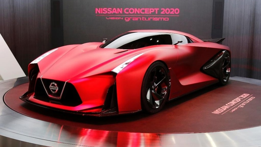 In this Oct. 28, 2015 photo, Nissan Concept 2020 is displayed at the Tokyo Motor Show in Tokyo.  Nissan's profit for the July-September quarter zoomed 38 percent higher on healthy sales in China, the U.S. and Europe, prompting the automaker to raise its full-year projections. Yokohama, Japan-based Nissan Motor Co. reported Monday, Nov. 2, 2015, a fiscal second quarter profit of 172.8 billion yen ($1.4 billion), up from 124.9 billion yen the year before. (AP Photo/Shuji Kajiyama)