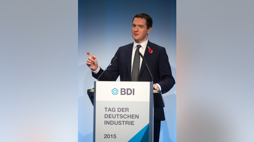 Britain's Chancellor of the Exchequer George Osborne,  delivers a speech  during a reception of the Federation of German Industries (BDI) in Berlin, Germany, Tuesday, Nov. 3, 2015.  ( Bernd von Jutrczenka/dpa via AP)