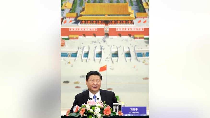 China's President Xi Jinping attends a meeting of the second Understanding China Conference, in Beijing, China, Tuesday, Nov. 3, 2015. President Xi Jinping said Tuesday that China needs at least 6.5 percent economic growth in coming years and the Communist Party announced plans to let its tightly controlled yuan trade freely by 2020. (Jason Lee/Pool Photo via AP)