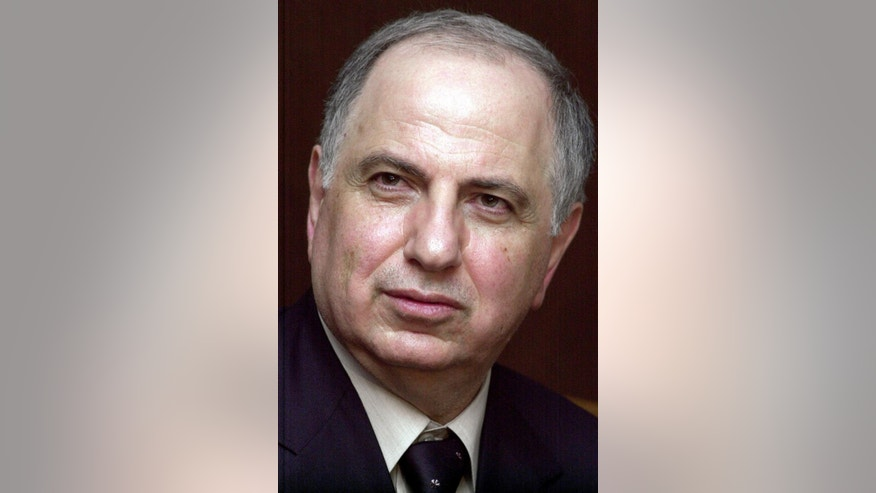 FILE - In this Monday, Jan. 27, 2003 file photo, Iraqi National Congress leader Ahmad Chalabi, speaks to the media at in Tehran, Iran. Iraqi state TV says Chalabi, a prominent politician who strongly advocated the 2003 U.S.-led invasion to overthrow Saddam Hussein, has died of a heart attack. (AP Photo/Vahid Salemi, File)