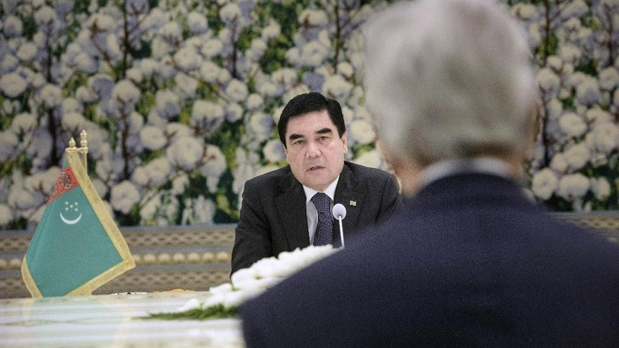 Turkmenistan President Gurbanguly Berdimuhamedov background talks, during a meeting with US Secretary of State John Kerry, at the Oguzkhan Presidential Palace in Ashgabat, Turkmenistan, Tuesday, Nov. 3, 2015. U.S. Secretary of State John Kerry ventured Tuesday to a place few world leaders and even fewer journalists or human rights monitors ever see, dangling the opportunity of greater U.S. investment, expanded security cooperation and a strategic counterweight to nearby Russia and China if the government improves its human rights record. (Brendan Smialowski/Pool Photo via AP)