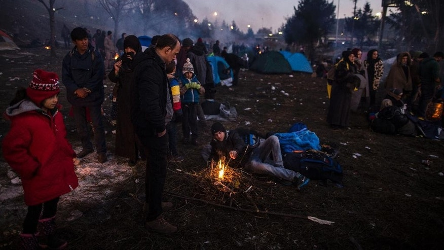 Migrants rest near the Slovenian-Austrian border, before being allowed to cross the border, at Sentilj, Slovenia,  Monday Oct. 2, 2015.  The influx of many hundreds of thousands of migrants into the European bloc over this year, is putting extreme pressure on local communities especially in border countries.  (AP Photo /Manu Brabo)
